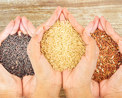 3 pairs of hands holding rice