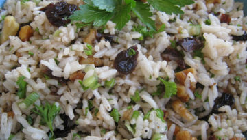 Overhead image ofBalsamic Cherry Rice Salad with Toasted Walnutsin a blue bowl
